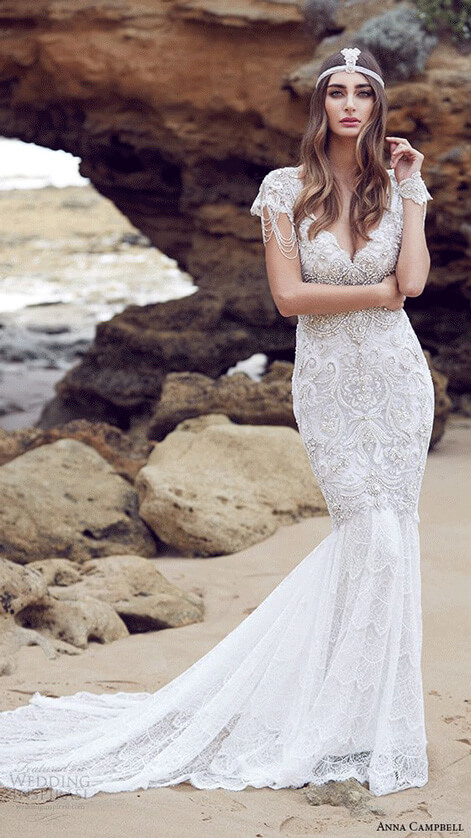 This Whimsy Lace Goddess Wedding Gown Features Applique Illusion Long Sleeve And Special High Low Train The Asymmetrical Shape Gives Dress A Romantic